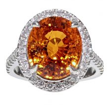 Oval Cut Garnet And Diamond Ring